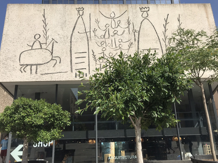 Picasso always loved all things Catalonia and portraited the local giants.  Frieze made by Carl Nesjar following Picasso sketches.  Plaça Nova, Barcelona
